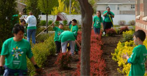 Photography by Leah Hogsten Students and volunteers spruced up the landscaping, cleaned and improved playgrounds around Mountain View Elementary and Glendale Middle Schools April 30, 2016. Saturday, April 30, 2016, More than 7,000 Comcast employees, their families and community volunteers in Utah will assisted students and community members in need at 19 service projects at local schools, city parks, and The Road Home.