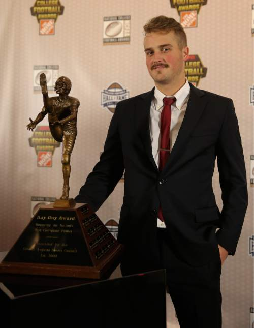 Utah's Tom Hackett  poses with the trophy after winning the Ray Guy Award for being the nation's top punter at the College Football Hall of Fame, Thursday, Dec. 10, 2015, in Atlanta. (AP Photo/John Bazemore)