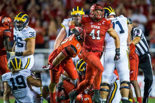Chris Detrick  |  The Salt Lake Tribune Utah Utes linebacker Jared Norris (41) celebrates after tackling Michigan Wolverines running back De'Veon Smith (4) during the second half of the game at Rice-Eccles Stadium Thursday September 3, 2015.  Utah defeated Michigan 24-17.
