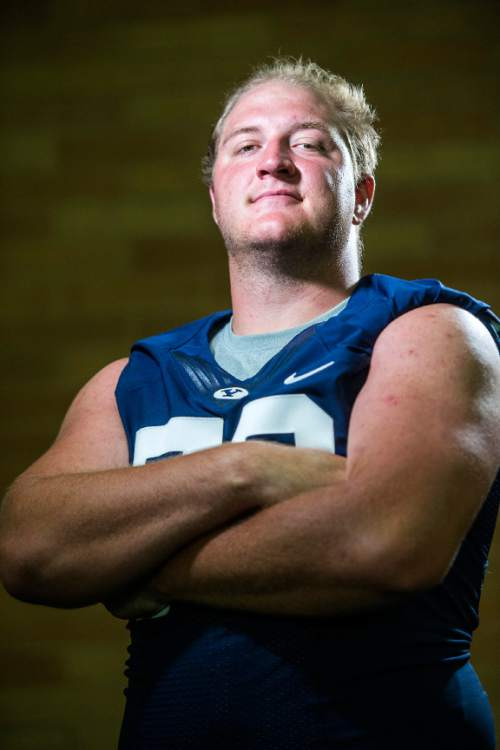 Chris Detrick  |  The Salt Lake Tribune Brigham Young Cougars offensive lineman Ryker Mathews (72) poses for a portrait Wednesday August 12, 2015.