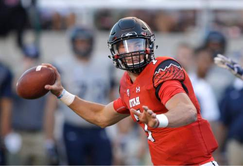 FILE - In this Sept. 11, 2015, file photo, Utah quarterback Travis Wilson prepares to pass during the first half of an NCAA college football game against Utah State in Salt Lake City. The play of Wilson was a huge reason the Utes shot up the rankings and now sit at No. 4. The play of Wilson is also the reason why there are questions about the Utes' legitimacy. (AP Photo/Rick Bowmer, File)