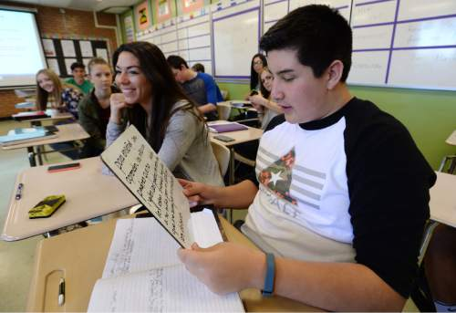 Steve Griffin  |  The Salt Lake Tribune   Mayte Rodriquez smiles as Clay Newman reads here answer to a question as they attend Indgrid Campos' AP Spanish class at Layton High School, in Layton, Utah Thursday, April 7, 2016. The first cohort of students who enrolled in Utah's dual immersion programs are now reaching the age where they can take high school AP language courses for college credit.