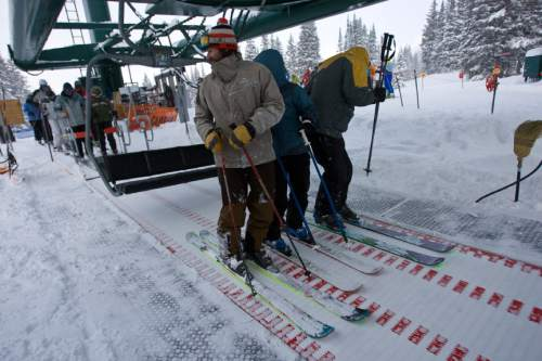 "Chris Detrick  |  The Salt Lake Tribune  Skiers slide forward on a new conveyor belt that eases loading onto the Supreme chair lift at Alta Ski Area.  The ""loading carpet"" is used in a number of European resorts."