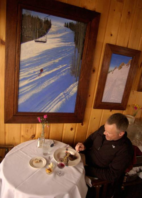Francisco Kjolseth  |  The Salt Lake Tribune  Bryan Harter of Austin, TX., enjoys an upscale desert at Collins Grill, upstairs from the cafeteria at the Watson Shelter, mid-mountain at Alta on April 11, 2005. Harter who has visited Alta to ski every year since 1977 is one of the last few that will enjoy the place before it closes on April 17. The antiquated building will be torn down and replaced with a new restaurant that will be built near the angle station of the new Collins lift.