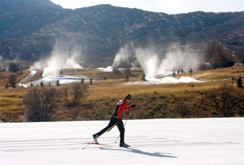Al Hartmann     The Salt Lake Tribune  Cross Country skier finishes a loop around the 3K track at Soldier Hollow Cross County  Center Ski Resort near Midway on Monday January 9, 2012 as snow making machines spray out man-made snow to make up for the deficit of natural snow for this time of year.