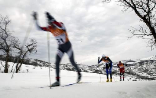Men's 50K classic skiiers head into scrub oak forrest on the long 12.5K loop during the race.  Hartmann/photo   2/23/02