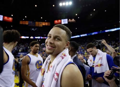 Golden State Warriors' Stephen Curry smiles a the end of a 125-104 win over the Memphis Grizzlies during an NBA basketball game Wednesday, April 13, 2016, in Oakland, Calif. (AP Photo/Marcio Jose Sanchez)