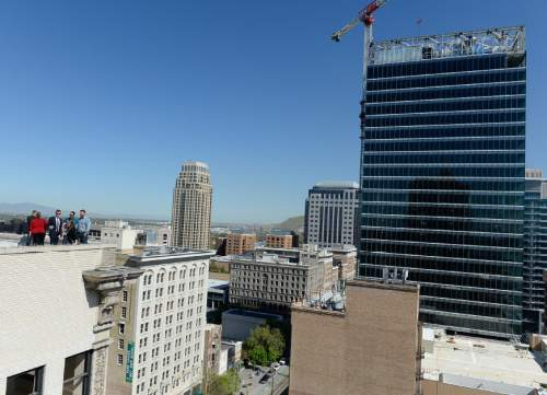 Francisco Kjolseth | The Salt Lake Tribune  Local leaders give an update on the ongoing Downtown Rising projects from the rooftop of the Walker Center that overlooks Main street on Tuesday, May 3, 2016, as the initiative celebrates ten years.