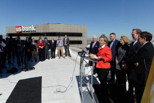 Francisco Kjolseth | The Salt Lake Tribune  Local leaders, including Natalie Gochnour, Associate Dean David Eccles School of Business, University of Utah, as they give an update on the ongoing Downtown Rising projects from the rooftop of the Walker Center on Tuesday, May 3, 2016, as the initiative celebrates ten years.