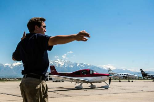 Chris Detrick     The Salt Lake Tribune Leading Edge Aviation Line Service Technician Ethan Polzin marshals in an airplane at South Valley Regional Airport in West Jordan on Tuesday.