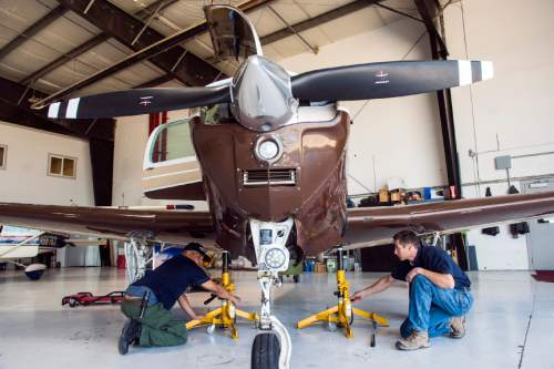 Chris Detrick     The Salt Lake Tribune  Leading Edge Aviation maintenance technicians Reed Hatch, right, and Scott Batista work on an airplane at South Valley Regional Airport in West Jordan Tuesday May 3, 2016.
