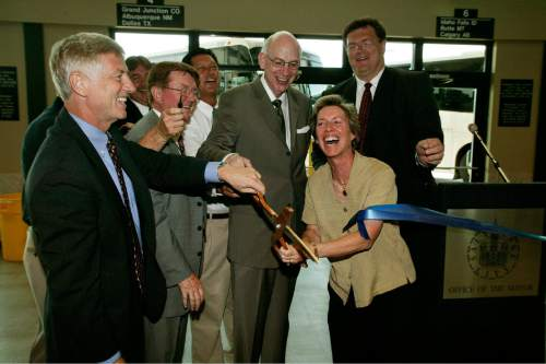 |  Tribune File Photo  Office holders current and former of various Utah positions are on hand to cut the ribbon at the Greyhound depot. Among them from left to right, are Salt lake City Mayor Rocky Anderson, left, John Inglish of UTA, SLC Council member Van Turner, Senator Bob Bennett,  former Salt Lake City mayor Dee Dee Corradini, and SLC Council member Carlton J. Christensen.  The new building is part of a larger Intermodal Hub building that will also contain train, light rail and bus lines.   The hub is located at 300 South and 600 West and will contain some retail.