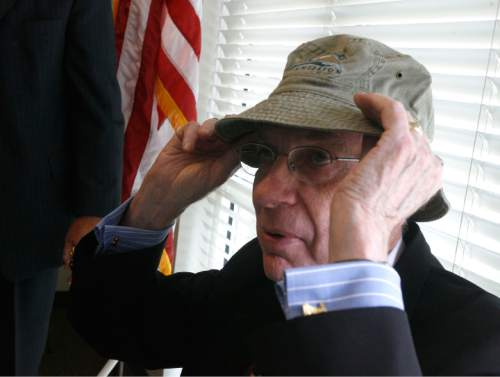 Rick Egan  |  The Salt Lake Tribune     Senator Bob Bennett tries on the hat he was given as a gift by the Utah Lake Commission, during a press conference at Utah Lake State Park, Friday, June 26,  2009.  State and Utah County officials formally signed the Utah Lake Master Plan, the document that will guide the restoration and preservation of the lake habitat.