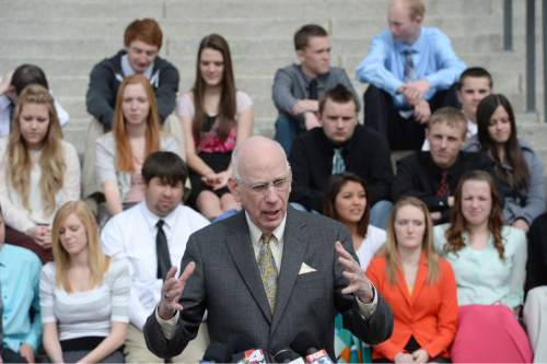 Steve Griffin  |  The Salt Lake Tribune  With students from Canyon View High School in Cedar City behind him former U.S. Sen. Bob Bennett  talks during announcement of the formation of the ìUtah Debate Commission, an independent and bipartisan group that will plan, host, produce, and televise debates among candidates for statewide and federal office. The event was held on the Utah State Capitol Steps in Salt Lake City, Utah Monday, February 24, 2014.