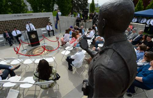 Steve Griffin / The Salt Lake Tribune  People gather at the Utah Law Enforcement Memorial, West lawn in Salt Lake CityThursday May 5, 2016 as the Utah law enforcement community held its annual memorial to police officers killed in the line of duty during the previous year.