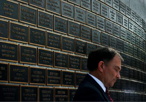 Steve Griffin / The Salt Lake Tribune  Gov. Gary Herbert bows his head for a prayer as the Utah law enforcement community held its annual memorial to police officers killed in the line of duty during the previous year at the State Capitol, Utah Law Enforcement Memorial, West lawn in Salt Lake CityThursday May 5, 2016.