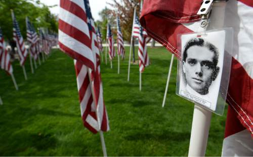Steve Griffin / The Salt Lake Tribune  Flags wave in the breeze at the Utah Law Enforcement Memorial, West lawn in Salt Lake CityThursday May 5, 2016 as the Utah law enforcement community held its annual memorial to police officers killed in the line of duty during the previous year. Each flag had a photograph of a fallen officer attatched.