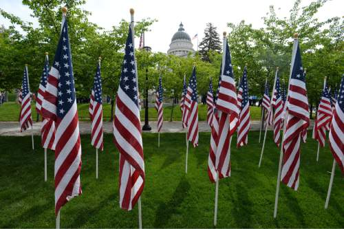 Steve Griffin / The Salt Lake Tribune  Flags wave in the breeze at the Utah Law Enforcement Memorial, West lawn in Salt Lake CityThursday May 5, 2016 as the Utah law enforcement community held its annual memorial to police officers killed in the line of duty during the previous year.