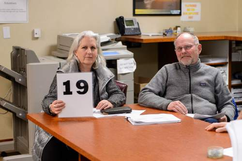 Trent Nelson     The Salt Lake Tribune Terry Tempest Williams (holding her bidding number) and Brooke Williams in the BLM's Salt Lake City office, Tuesday February 16, 2016. National protesters mobbed a routine oil & gas lease auction Tuesday at the Salt Palace, where Tempest Williams tried to bid on parcels with the hopes of keeping them from being drilled. She ended up submitting an offer after the auction on a parcel that failed to attract the minimum $2-an-acre bid.
