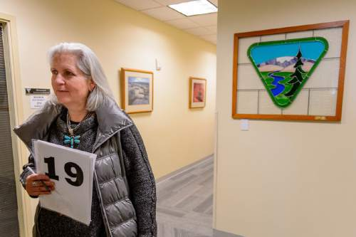 Trent Nelson     The Salt Lake Tribune Author Terry Tempest Williams with her bidding number in the BLM's Salt Lake City office, Tuesday February 16, 2016. National protesters mobbed a routine oil & gas lease auction Tuesday at the Salt Palace, where Tempest Williams tried to bid on parcels with the hopes of keeping them from being drilled. She ended up submitting an offer after the auction on a parcel that failed to attract the minimum $2-an-acre bid.