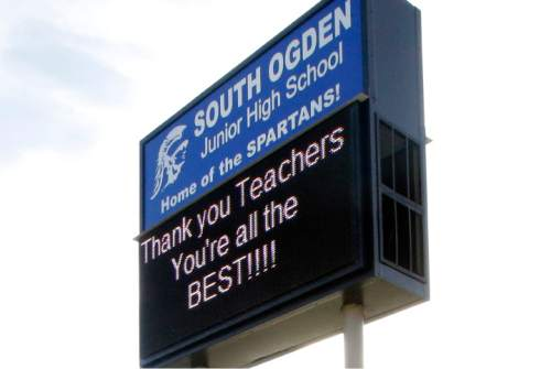 "The South Ogden Junior High School sign is shown Wednesday, May 4, 2016, in South Ogden, Utah. An official says a white Utah teacher violated school district policy by using a racially charged word in his junior high class. History teacher Douglas Barker used the N-word before showing his class of 8th graders the Civil War movie ""Glory."" Parent Holly Frye said her 14-year-old son doesn't feel safe at school after the experience last month. (AP Photo/Rick Bowmer)"