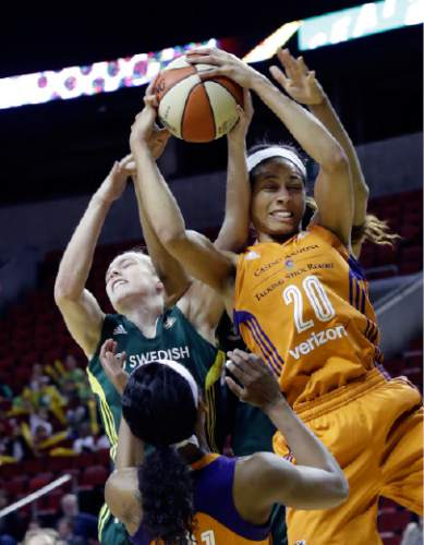 Seattle Storm's Lexi Eaton Rydalch, left, and Phoenix Mercury's Isabelle Harrison vie for a rebound in the second half of a WNBA preseason basketball game Wednesday, May 4, 2016, in Seattle. The Mercury won 81-73. (AP Photo/Elaine Thompson)