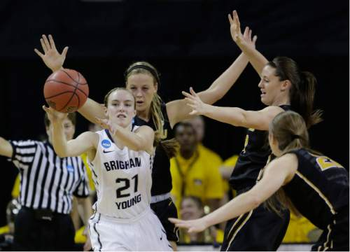Brigham Young guard Lexi Eaton Rydalch (21) is pressured by Missouri defenders as she tries to pass during a first-round women's college basketball game in the NCAA Tournament, Saturday, March 19, 2016, in Austin, Texas. (AP Photo/Eric Gay)