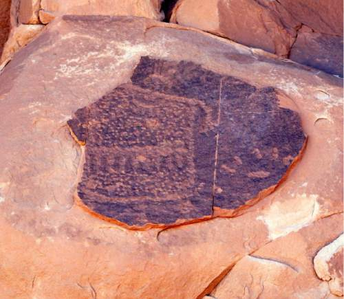 Josh Ewing  |  Friends of Cedar Mesa  Utah hiking guide Vaughn Hadenfelt discovered this act of vandalism at a rock art site a few miles west of Bluff during a recent outing. Would-be thieves attempted to remove this ancient petroglyph, but wound up ruining it. A new standing reward program administered by BLM and funded by Friends of Cedar Mesa will give $2,500 for information leading to the arrest of looters and vandals who are damaging Utah's archaeological sites.