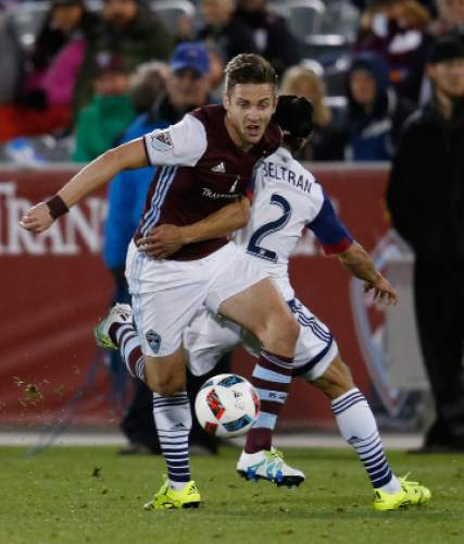 Colorado Rapids forward Kevin Doyle, left, pursues the ball as Real Salt Lake defender Tony Beltran defends in the second half of an MLS soccer game in Commerce City, Colo., late Saturday, May 7, 2016. The Rapids won 1-0. (AP Photo/David Zalubowski)