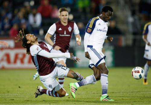 Colorado Rapids midfielder Jermaine Jones, left, reacts after losing control of the ball to Real Salt Lake midfielder Stephen Sunny Sunday in the second half of an MLS soccer game in Commerce City, Colo., late Saturday, May 7, 2016. The Rapids won 1-0. (AP Photo/David Zalubowski)