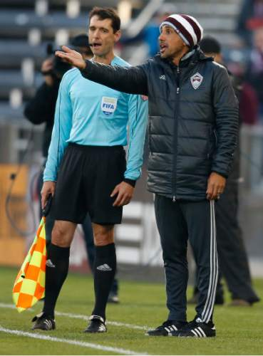 Colorado Rapids head coach Pablo Mastroeni argues a call against his team while facing Real Salt Lake in the first half of an MLS soccer game in Commerce City, Colo., late Saturday, May 7, 2016. (AP Photo/David Zalubowski)