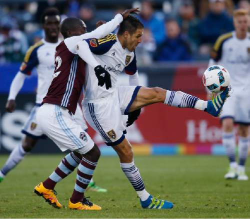 Colorado Rapids midfielder Michael Azira, left, defends against Real Salt Lake forward Juan Martinez in the first half of an MLS soccer game in Commerce City, Colo., late Saturday, May 7, 2016. (AP Photo/David Zalubowski)