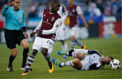 Real Salt Lake forward Juan Martinez, right, grabs his leg after colliding with Colorado Rapids midfielder Michael Azira while pursuing the ball in the first half of an MLS soccer game in Commerce City, Colo., late Saturday, May 7, 2016. (AP Photo/David Zalubowski)