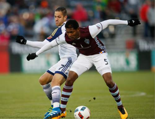 Real Salt Lake forward Juan Martinez, left, fights for control of the ball with Colorado Rapids defender Mekeil Williams in the first half of an MLS soccer game in Commerce City, Colo., late Saturday, May 7, 2016. (AP Photo/David Zalubowski)