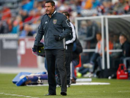 Real Salt Lake head coach Jeff Cassar directs his team against the Colorado Rapids in the first half of an MLS soccer game in Commerce City, Colo., late Saturday, May 7, 2016. (AP Photo/David Zalubowski)