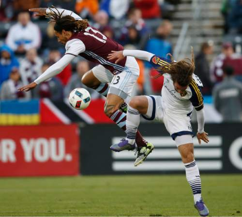 Colorado Rapids midfielder Jermaine Jones, left, collides with Real Salt Lake midfielder Kyle Beckerman while trying to he'd the ball in the first half of an MLS soccer game in Commerce City, Colo., late Saturday, May 7, 2016. (AP Photo/David Zalubowski)