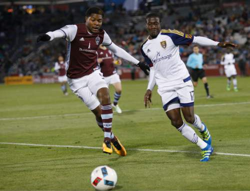 Colorado Rapids defender Mekeil Williams, left, fights for control of the ball with Real Salt Lake midfielder Demar Phillips in the second half of an MLS soccer game in Commerce City, Colo., late Saturday, May 7, 2016. The Rapids won 1-0. (AP Photo/David Zalubowski)