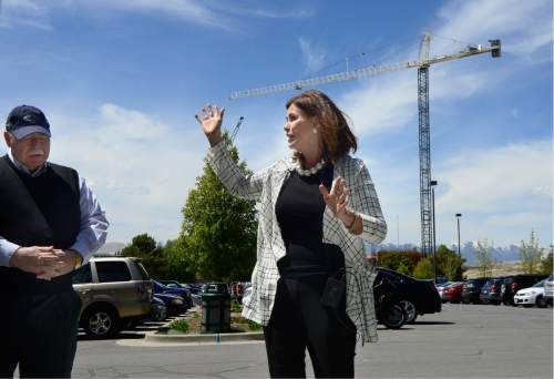 Scott Sommerdorf   |  The Salt Lake Tribune   Sally Dietlein, the Hale Centre Theatre's vice president - with Sandy Mayor Tom Dolan at left - describes the mid-construction point of the new 130,000 square-feet Hale Center theater from the Sandy City Hall parking lot, Wednesday, May 4, 2016. The theatre includes a smaller proscenium thrust (horseshoe-shaped) stage, and on the one-of-a-kind center stage in the theater-in-the-round.