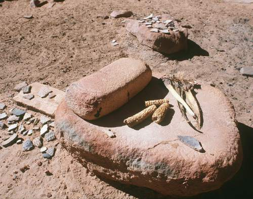 Al Hartmann  |  The Salt Lake Tribune  Anasazi grinding stone with assorted pottery chards and 700 year old corn cobs in a canyon on Cedar Mesa in San Juan County.  The area is included for a proposed Bears Ears National Conservation Area.