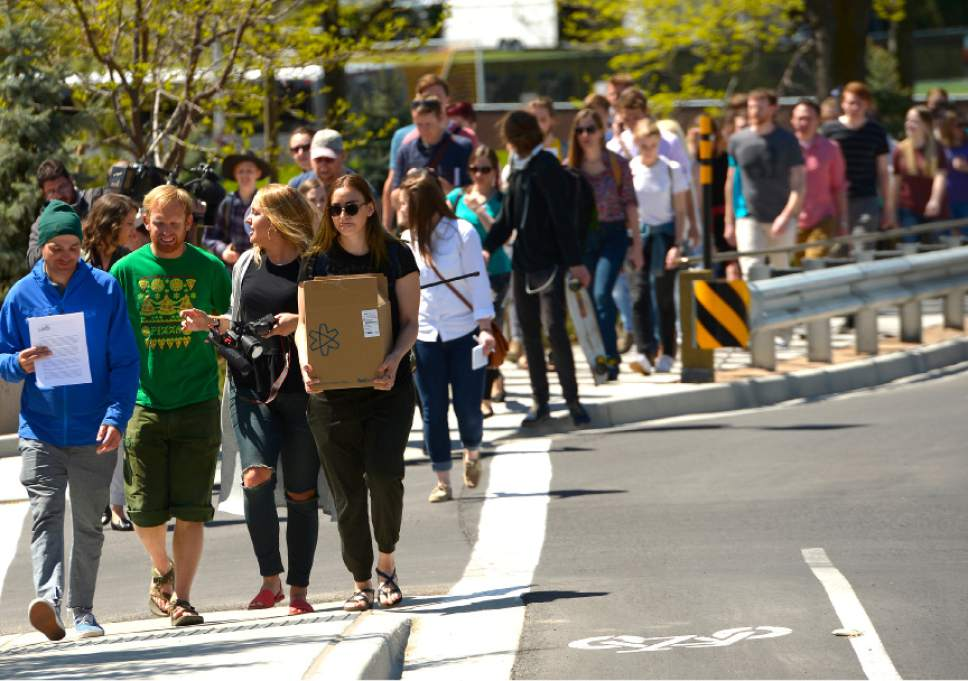 "Leah Hogsten  |  The Salt Lake Tribune Care2 petition supporters delivered 60,000  petition signatures to Brigham Young University's Abraham O. Smoot administration building, Wednesday, April 20, 2016 to protest the school's ""Honor Code"" and to ask the school to add an immunity clause shielding sexual assault victims from Honor Code investigations."