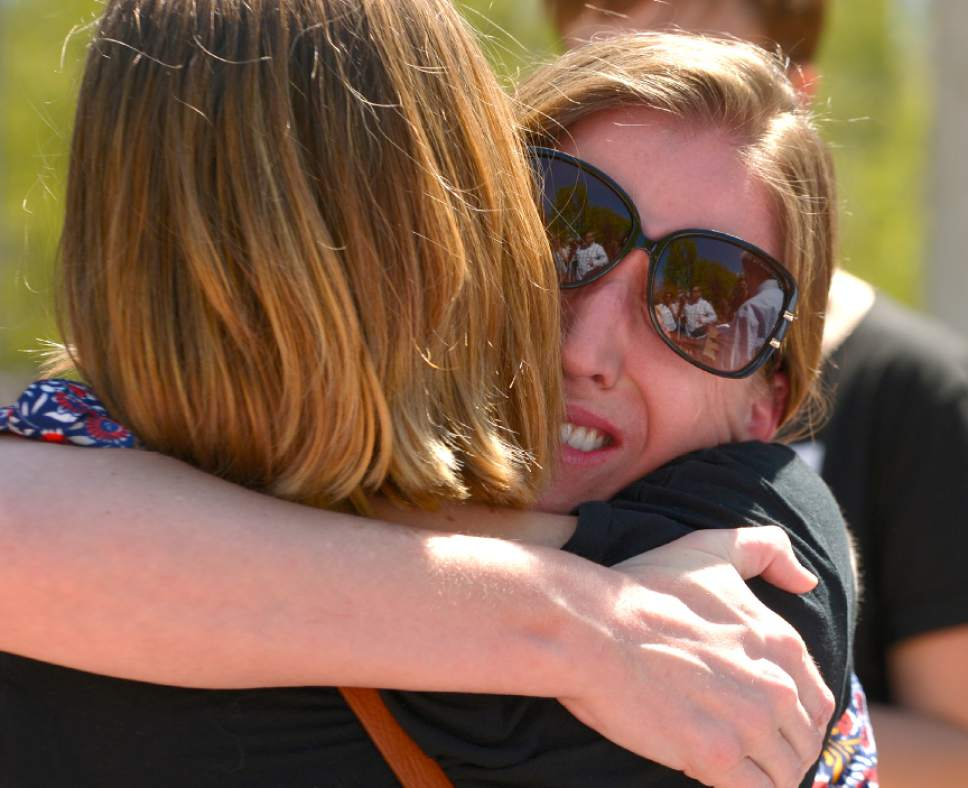 "Leah Hogsten  |  The Salt Lake Tribune ""I love this school,"" said Mindy Weston, right, hugging Care2 petition writer Kelsey Bourgeois, ""but they have to remove every impediment from a victim from coming forward."" Weston identified herself as a survivor of a sexual assault. Care2 petition supporters delivered 60,000 petition signatures to Brigham Young University's Abraham O. Smoot administration building, Wednesday, April 20, 2016 to protest the school's ""Honor Code"" and to ask the school to add an immunity clause shielding sexual assault victims from Honor Code investigations."