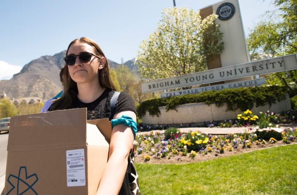 "Leah Hogsten  |  The Salt Lake Tribune Lauren Stratton carried the box of  60,000 signatures but said the group has over 90,000 signatures. Care2 petition supporters delivered 60,000  petition signatures to Brigham Young University's Abraham O. Smoot administration building, Wednesday, April 20, 2016 to protest the school's ""Honor Code"" and to ask the school to add an immunity clause shielding sexual assault victims from Honor Code investigations."