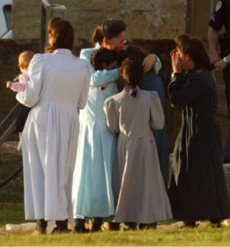 Trent Nelson  |  The Salt Lake Tribune  A group of FLDS women tearfully embrace after being reunited at Fort Concho, where they are temporarily being housed. FLDS women and children from the YFZ Ranch were escorted in several buses by Texas Child Protective Services workers and Texas State Troopers to Fort Concho in San Angelo, Texas Sunday, April 6, 2008.