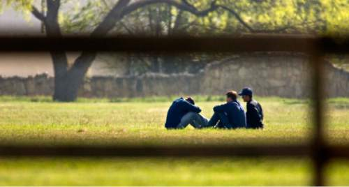 Trent Nelson  |  The Salt Lake Tribune  Three FLDS boys huddle at Fort Concho, where they are being held by Texas Child Protective Services Tuesday, April 8, 2008. CPS says they have taken 401 children from the YFZ Ranch into protective custody and brought them to Fort Concho.