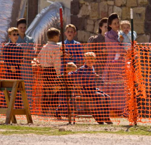 Trent Nelson  |  The Salt Lake Tribune  A group of children playing soccer under the supervision of FLDS women in a fenced-off area at Fort Concho, where they are being held by Texas Child Protective Services Tuesday, April 8, 2008. CPS says they have taken 401 children from the YFZ Ranch into protective custody and brought them to Fort Concho.