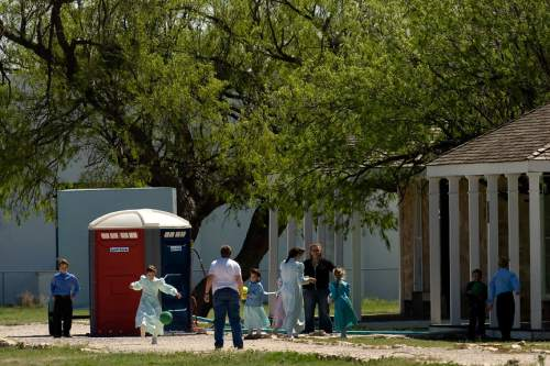 Chris Detrick  |  The Salt Lake Tribune  FLDS women and children play outside at Fort Concho in San Angelo, Texas, April 10, 2008, where they are being housed temporarily. Texas authorities said today that they have completed their investigation of the polygamous FLDS sect's YFZ Ranch at Eldorado and have left the property.