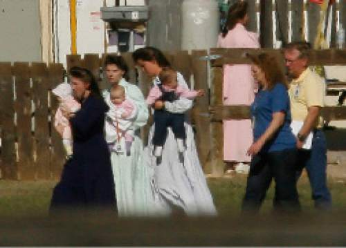 Chris Detrick  |  The Salt Lake Tribune  FLDS women and children walk outside at Fort Concho in San Angelo, Texas, on April 11, 2008, where they are being housed temporarily.Children removed from a polygamous sect's Texas ranch will remain in facilities here until a scheduled April 17 hearing on their status, officials said Friday. The 416 children from the YFZ Ranch, accompanied by 139 women, are staying at the Wells Fargo Pavilion and historic Fort Concho.