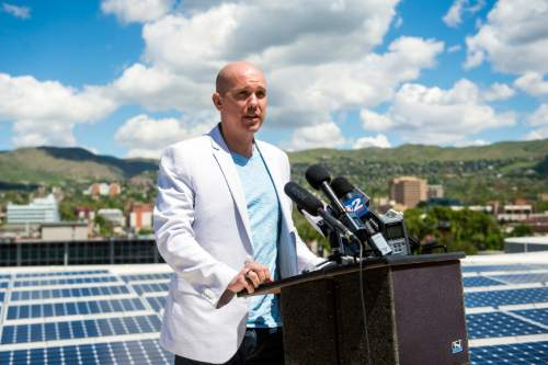 Chris Detrick  |  The Salt Lake Tribune Kiitos Brewing's Andrew Dasenbrock speaks during a press conference on top of the Salt Lake City Public Safety Building Tuesday May 10, 2016. Through the new initiative, Subscriber Solar, the city will nearly double the amount of sustainable energy powering government operations by the end of 2016. Mayor Biskupski has set a 2020 goal to have 50% of municipal operations powered by renewable energy, and 100% by 2032.