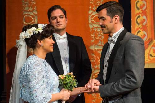 """Chris Detrick     The Salt Lake Tribune Utah Opera's Zulimar LÛpez-Hern·ndez 'Susanna,' Craig Irvin 'Count Almaviva' and Seth Carico 'Figaro,' perform during a rehearsal of """"The Marriage of Figaro"""" at the Capitol Theatre Wednesday April 27, 2016."""