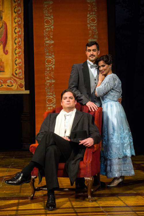 """Chris Detrick     The Salt Lake Tribune Utah Opera's Zulimar López-Hernández 'Susanna,' Craig Irvin 'Count Almaviva' and Seth Carico 'Figaro,' perform during a rehearsal of """"The Marriage of Figaro"""" at the Capitol Theatre Wednesday April 27, 2016."""